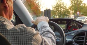 Old man driving car
