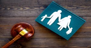 a gavel beside a family representing family law