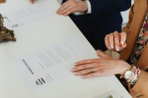couple signing a divorce paper